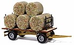 Hay Trailer - Assembled - w/Round Baled Load -- HO Scale Model Railroad Vehicle -- #44930