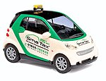 2007 Smart Fortwo Taxi (white, green) -- HO Scale Model Railroad Vehicle -- #46123