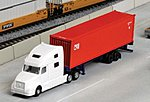 Volvo VN780 Tractor w/40' Corrugated Container on Chassis -- White Tractor w/CAI International Container (Red) - N-Scale